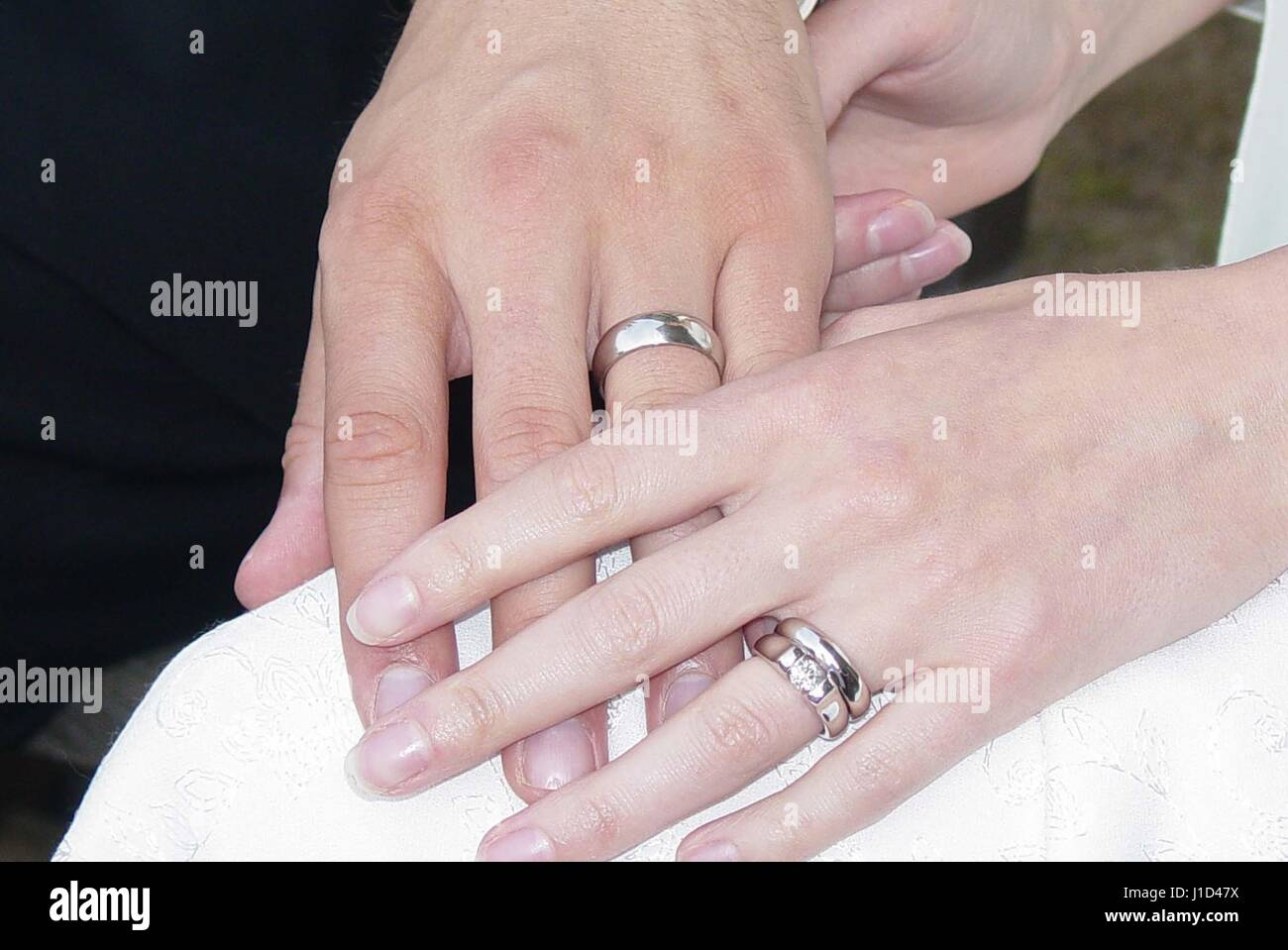 Husband And Wife Hold Hands Rings Stock Photos & Husband And Wife ...