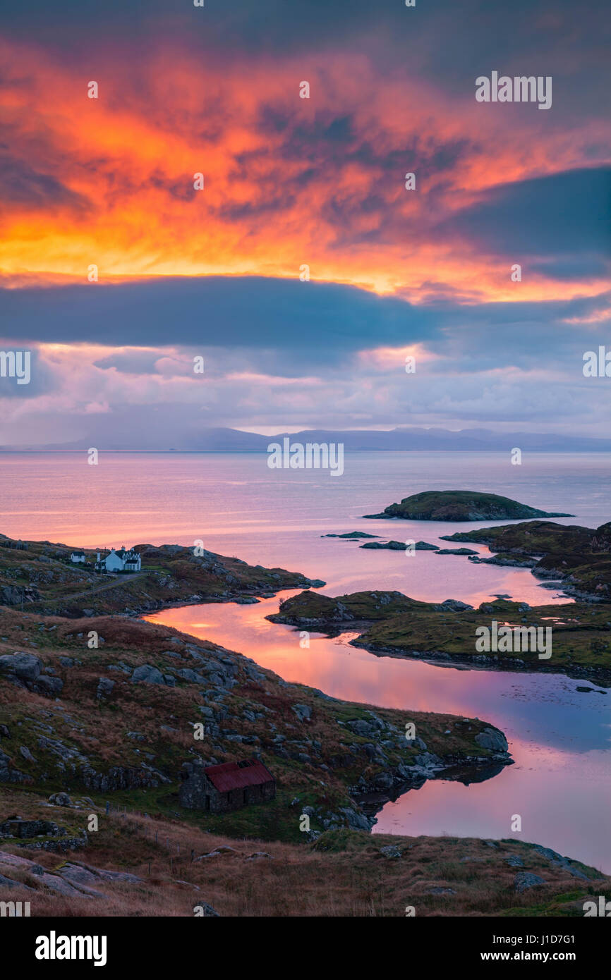Sunrise above Loch Ob Leasiad on the Isle of Harris with the Isle of Skye in the distance - Stock Image