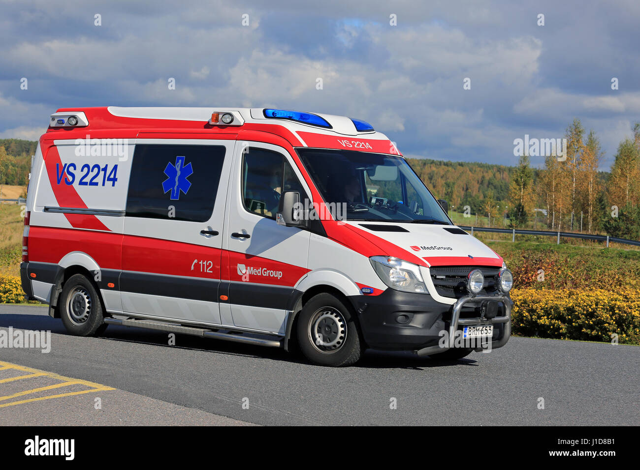 SALO, FINLAND - SEPTEMBER 18, 2016: Ambulance gets an emergency call and rushes ahead along road on a sunny autumn - Stock Image