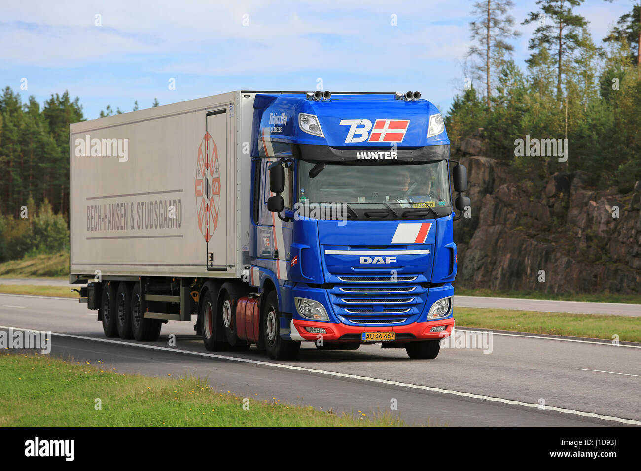 PAIMIO, FINLAND - SEPTEMBER 9, 2016: New blue DAF XF reefer truck of Torbjorn Bay moves along freeway in South of - Stock Image