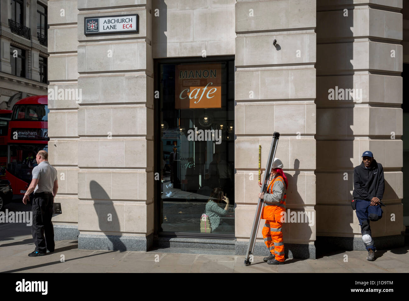 A land surveyor works in the City of London, the capital's financial district also known as the Square Mile, - Stock Image