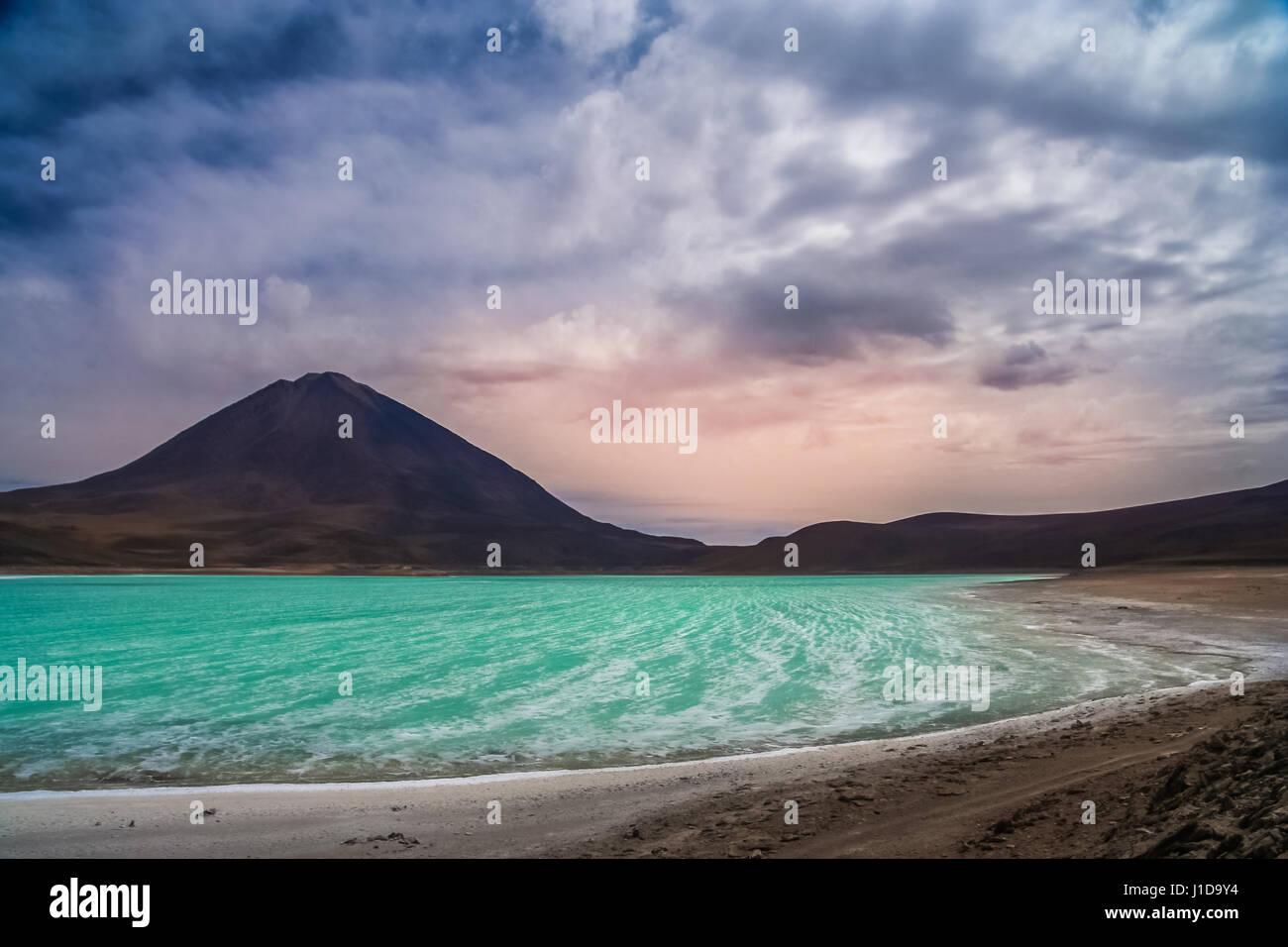Green lagoon called Laguna Verde in Altiplano mountains, southern Bolivia Stock Photo