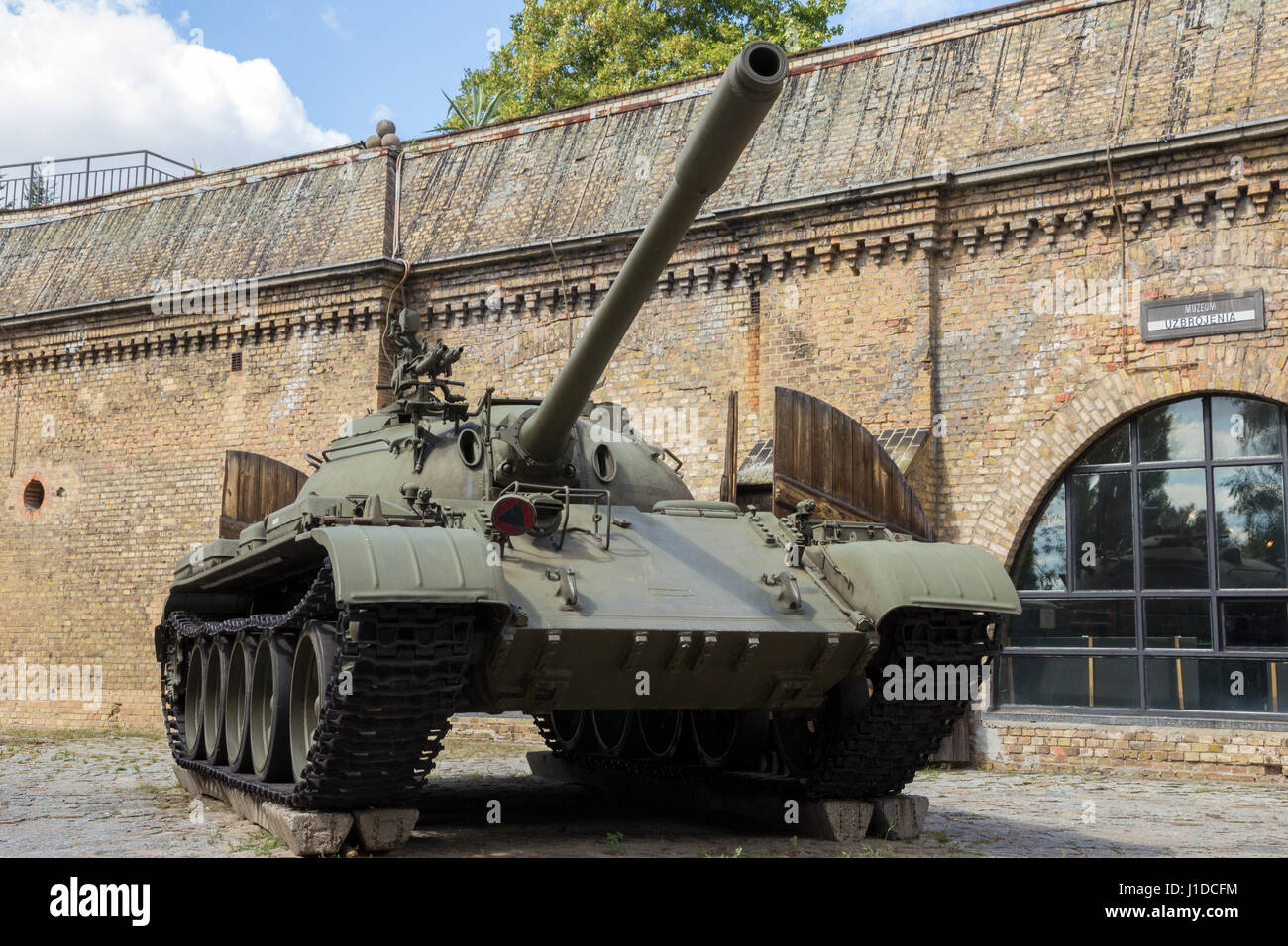 POZNAN, POLAND - AUG 20, 2014: Preserved T-55 tank on display in front of the Poznan Army Museum. Stock Photo