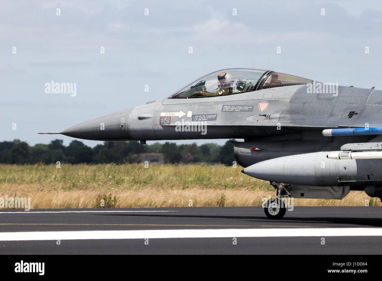 SCHLESWIG-JAGEL,  GERMANY - JUN 23, 2014: Lockheed Martin F-16 fighter jet plane on the runway during the NATO Tiger - Stock Image