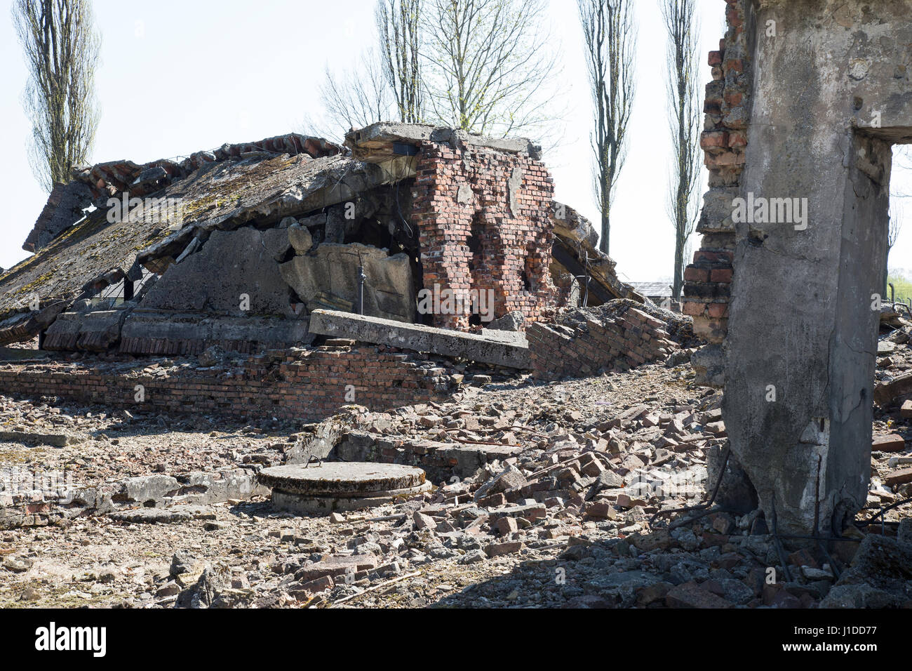 Ruins of crematorium ovens at Auschwitz Birkenau camp - Stock Image