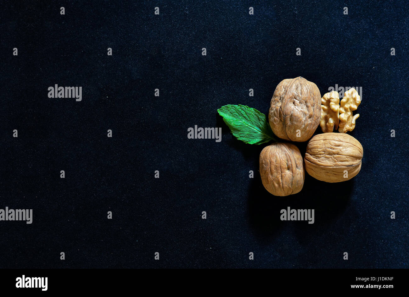 Group of walnuts in black background with copy space Stock Photo