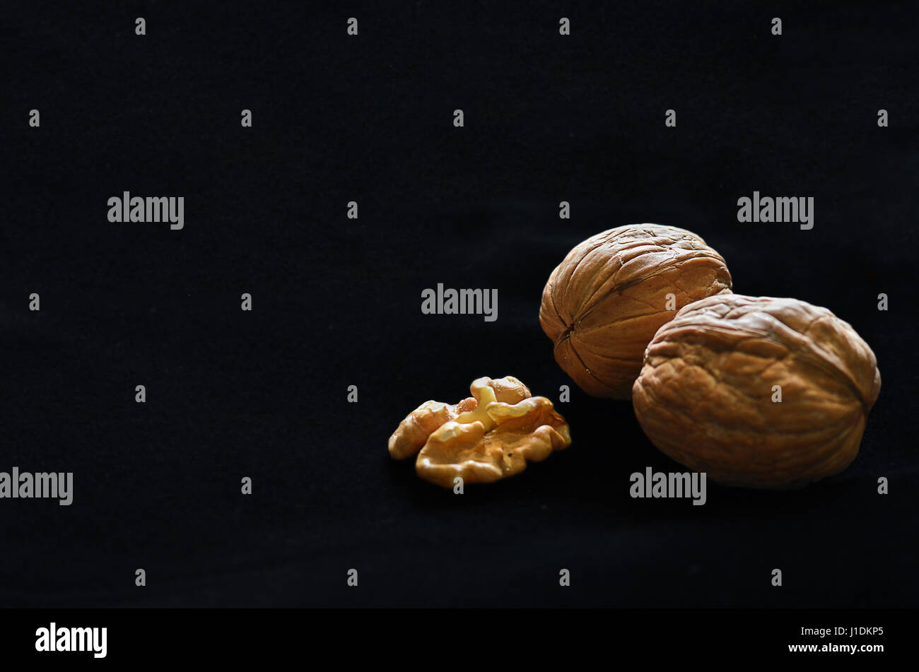 Walnuts in black background with copy space Stock Photo