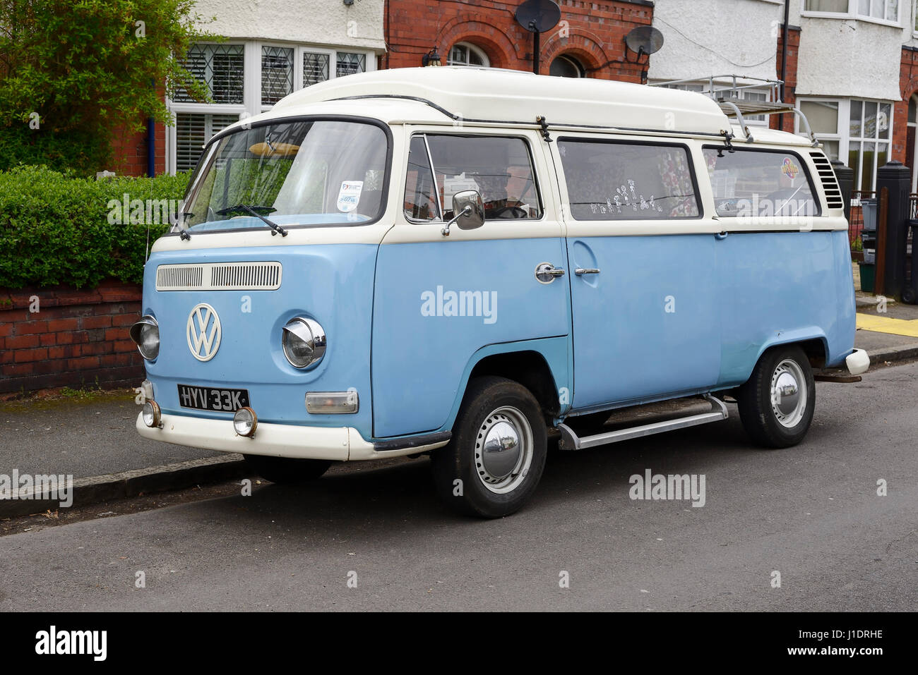 A vintage VW camper van from the year 1971 parked on a suburban street in Chester UK - Stock Image