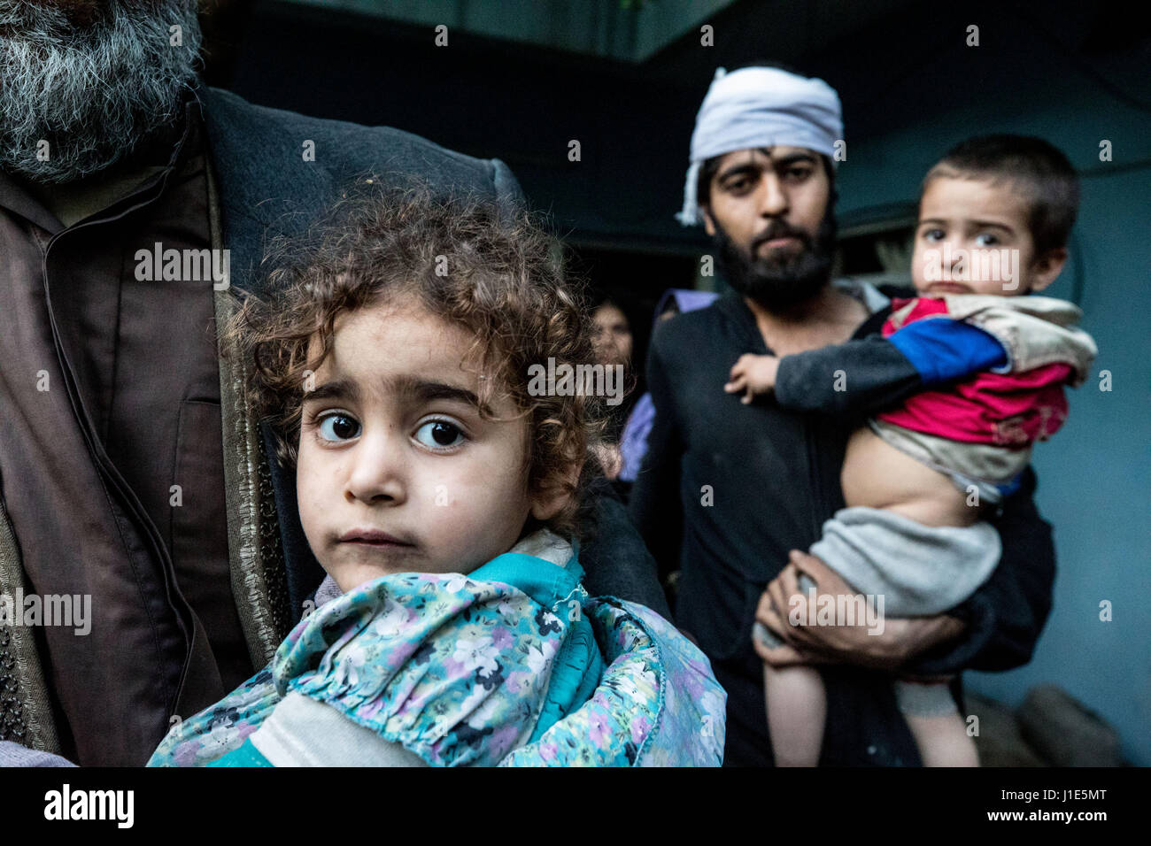 Mosul, Nineveh Province, Iraq. 19th Apr, 2017. Civilians are evacuated from a house in the Al Thawra neighborhood - Stock Image