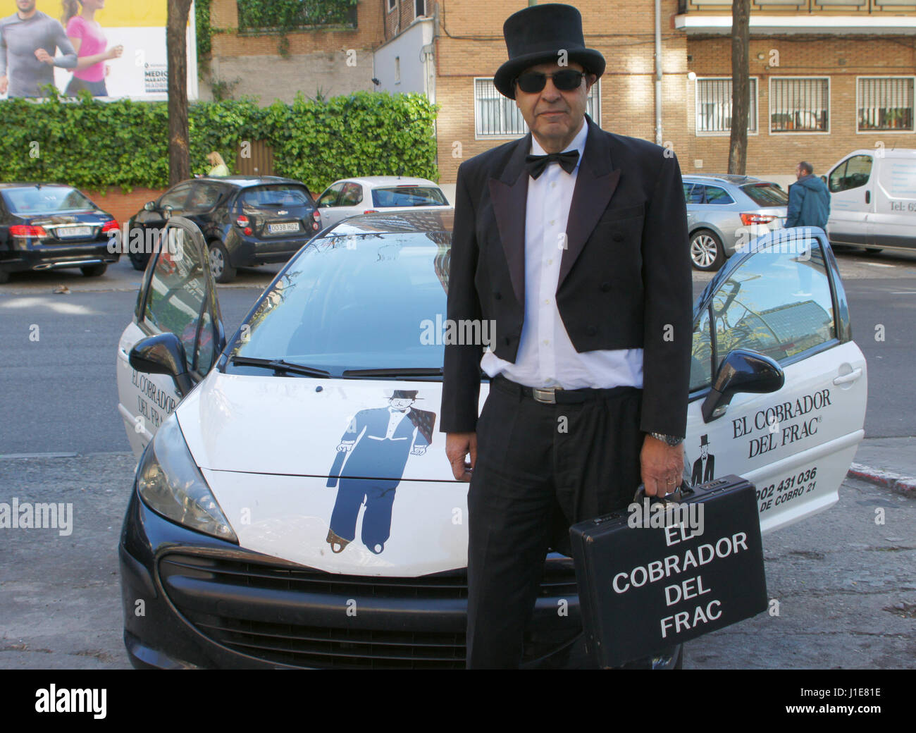 Madrid, Spain. 03rd Apr, 2017. Debt-collector Pedro Dediós stands dressed in his working clothes next to his - Stock Image