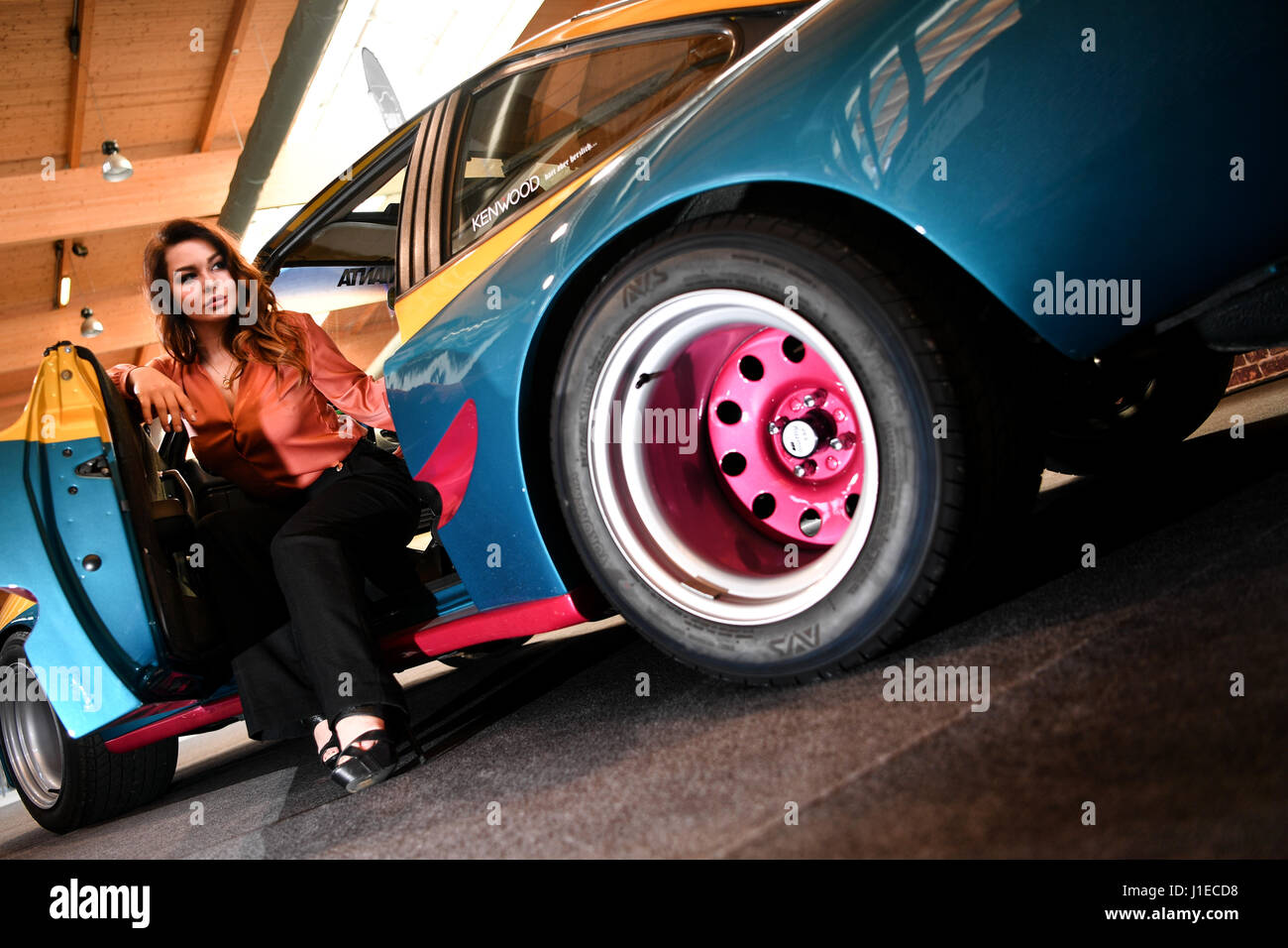 Friedrichshafen, Germany. 21st Apr, 2017. Miss Tuning Julia Oemler in a 180 hp, 6 cylinder Opel Manta B (1983) ahead - Stock Image