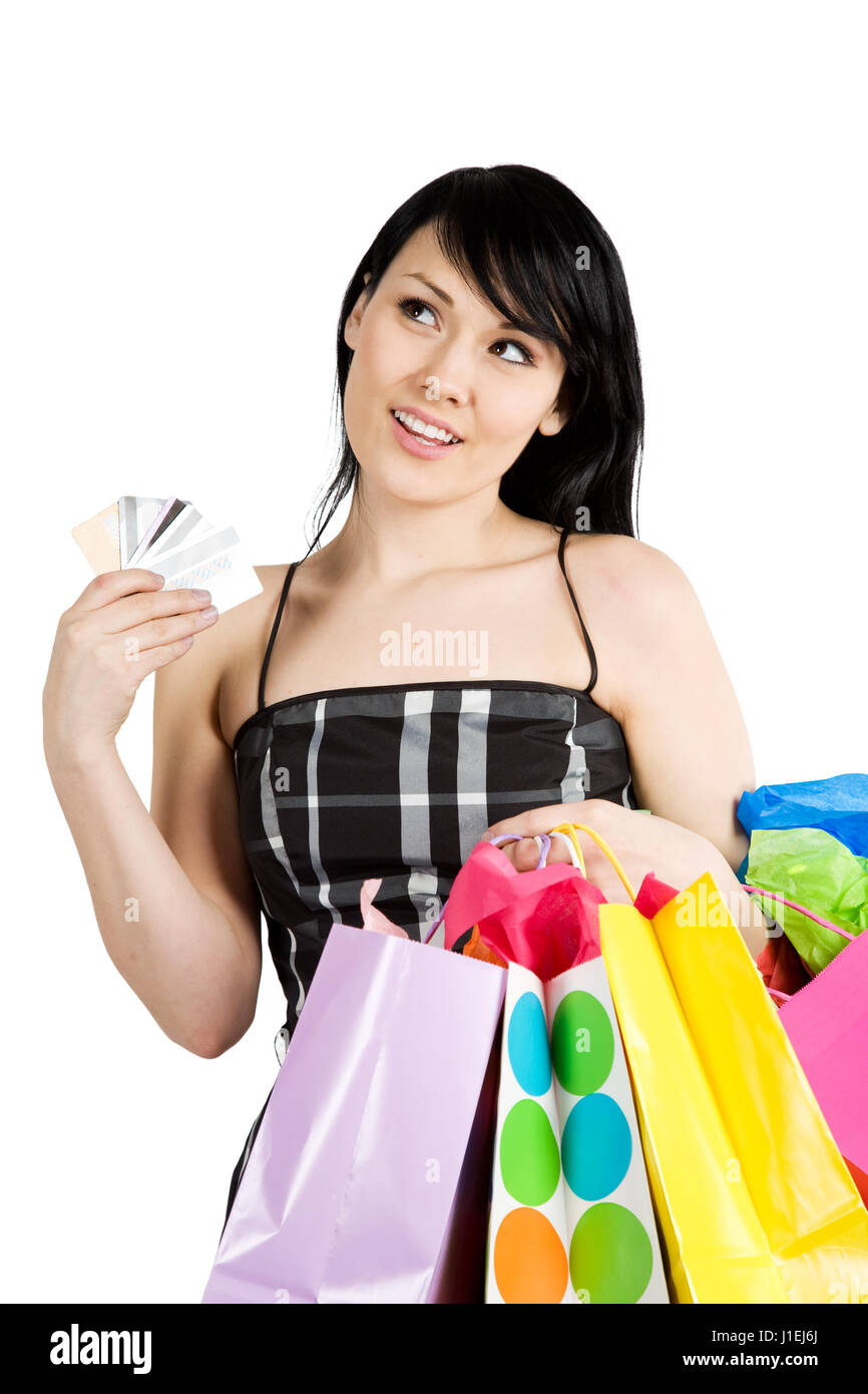 A beautiful woman carrying shopping bags and multiple credit cards Stock Photo