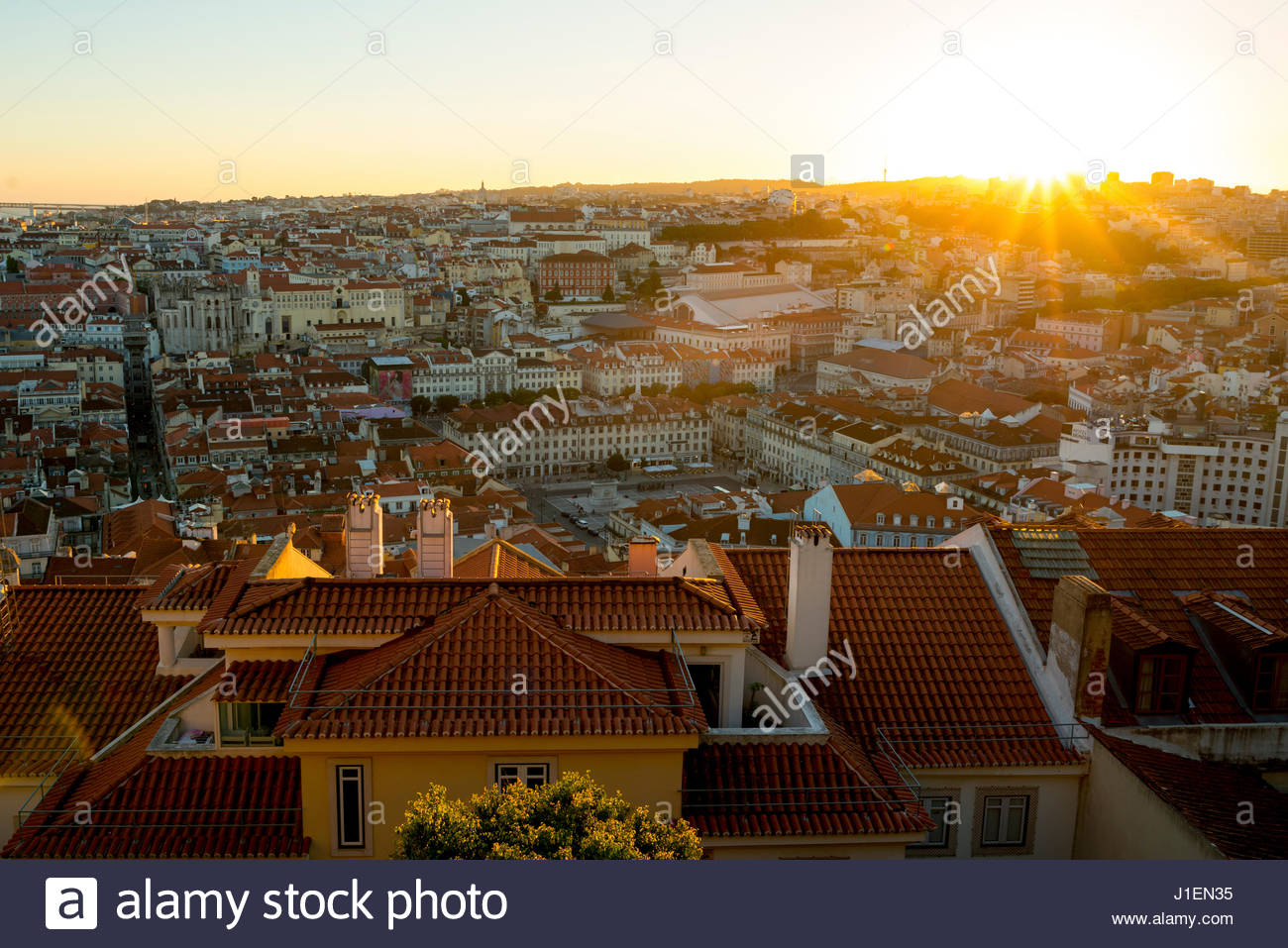 Sun shines over the roofs of Lisbon. - Stock Image