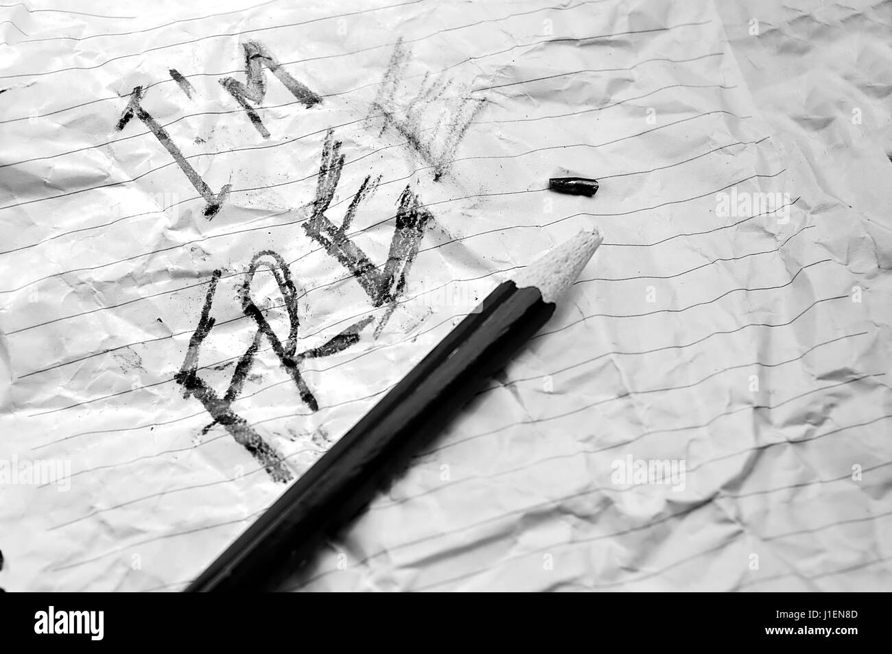 Crumpled paper with the expression I'm Free on it and a pencil with it´s tip broken - Stock Image
