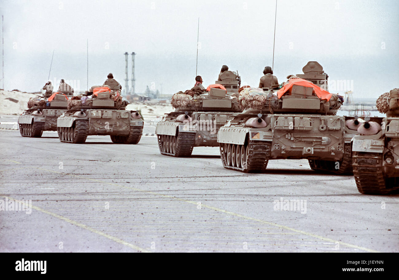 A Qatari tank company holds outside the border city of Khafji for the order to move into the battle against an unexpected - Stock Image