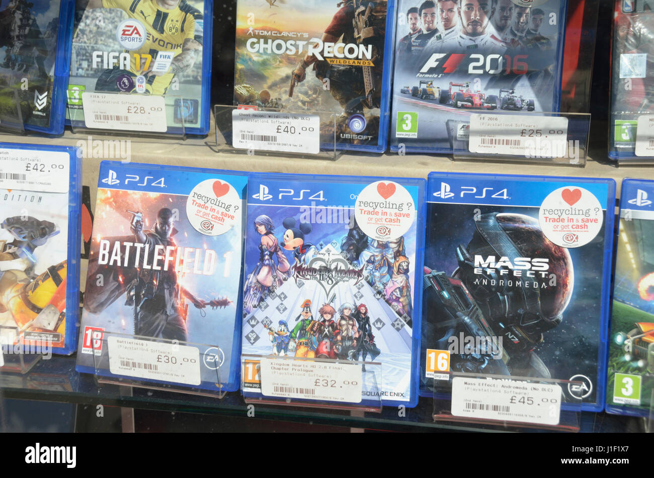 PS4 PlayStation video games on display in a shop window Stock Photo