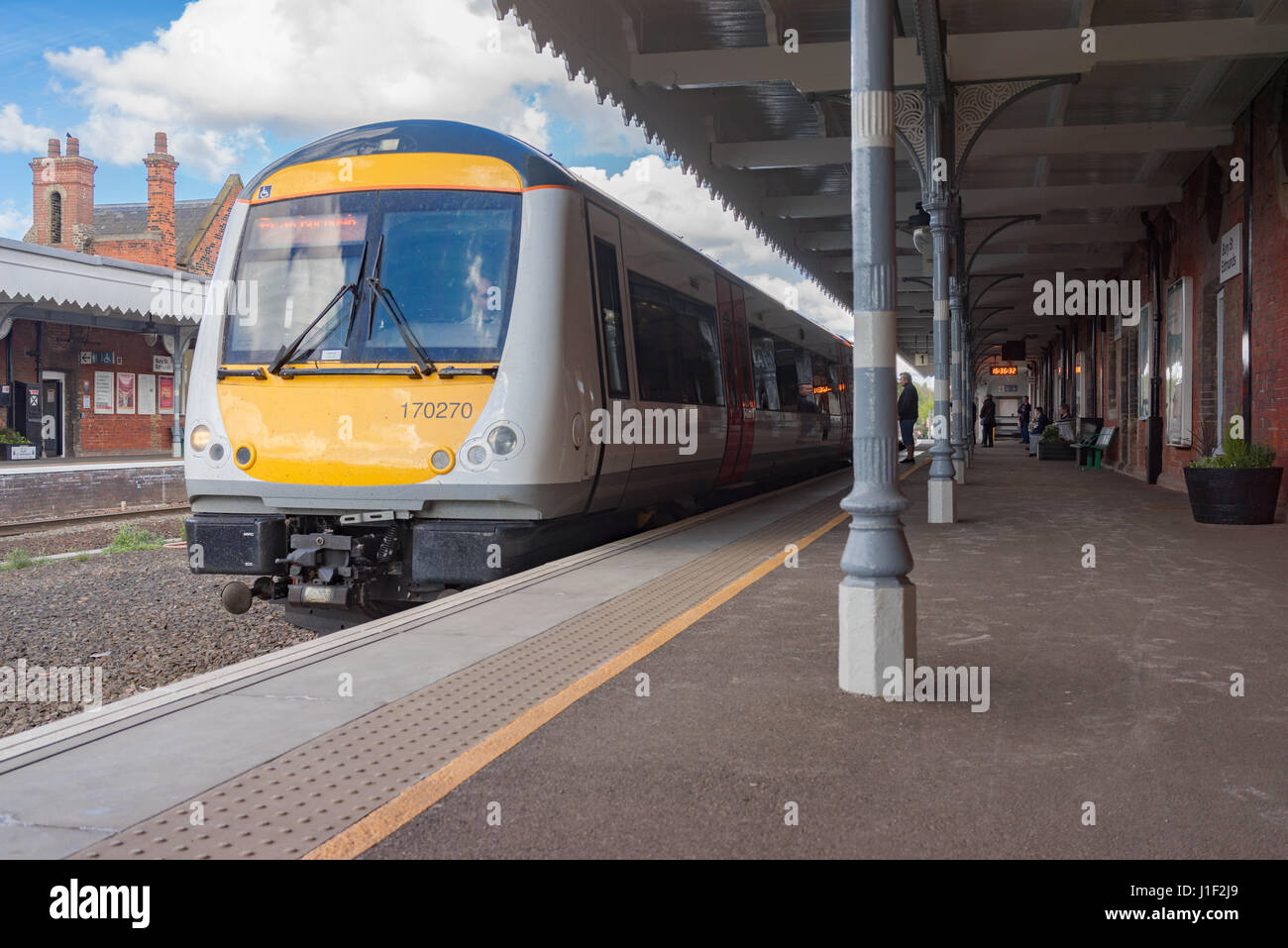 Class 170 DMU train at Bury St Edmunds Station in Suffolk, UK. - Stock Image