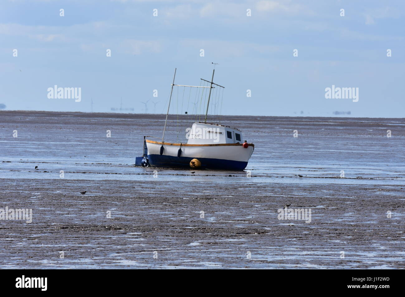 Boat stuck on a Mud Bank on Snettisham Beach at Low Tide