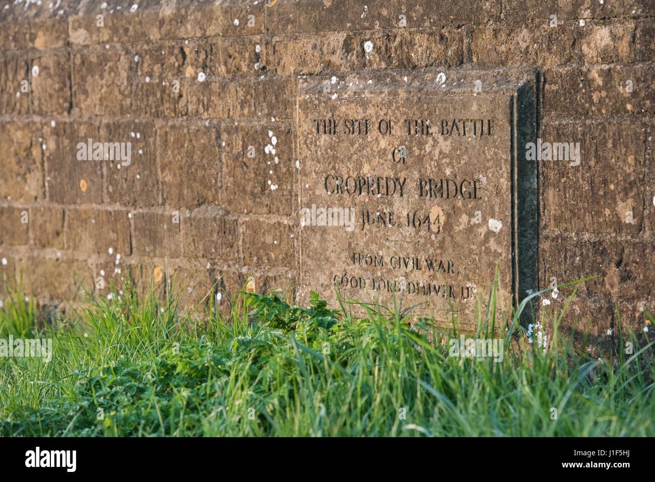 Battle of Cropredy Bridge stone plaque on the bridge in morning sunlight. Cropredy, Oxfordshire, England - Stock Image