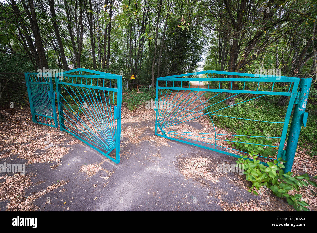 Gate of cemetery in Pripyat ghost city of Chernobyl Nuclear Power Plant Zone of Alienation around nuclear reactor - Stock Image
