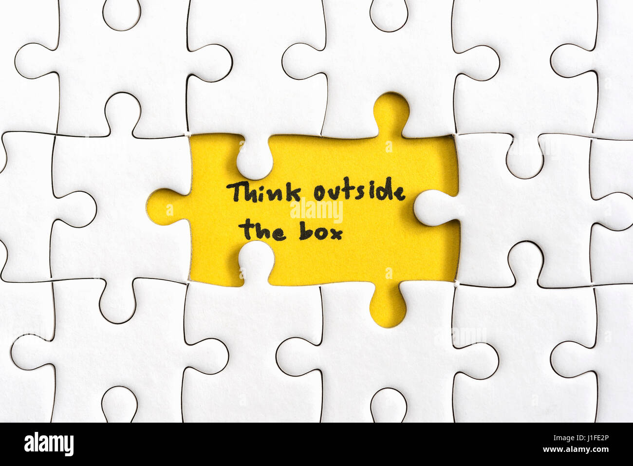 Jigsaw Puzzle Piece With Two Missing And Hand Writing Letters Word Think Outside The Box Quotes Business Concept