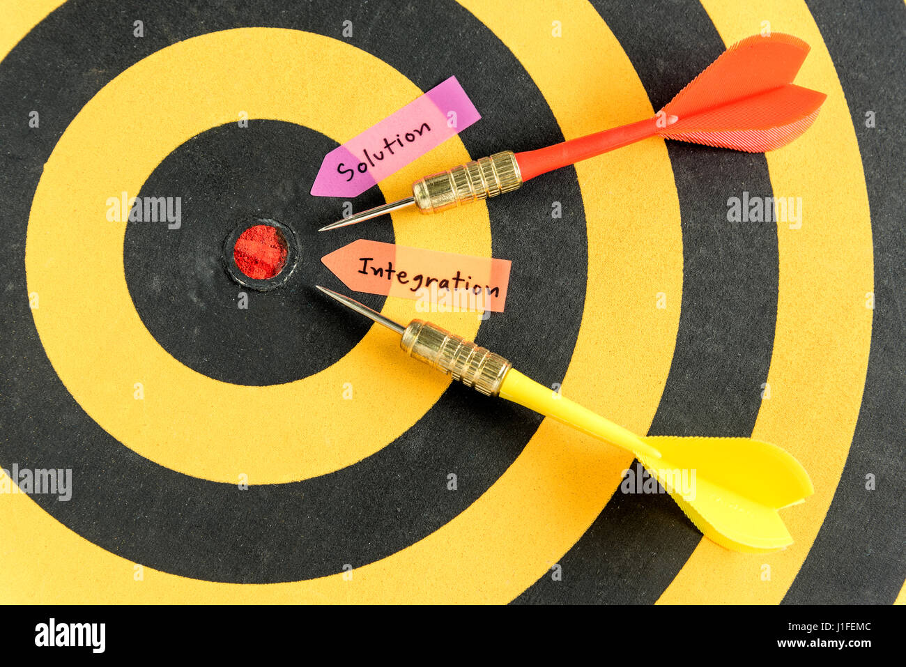 Handwriting solution integration with dart target near bullseye over dartboard background, abstract data concept - Stock Image