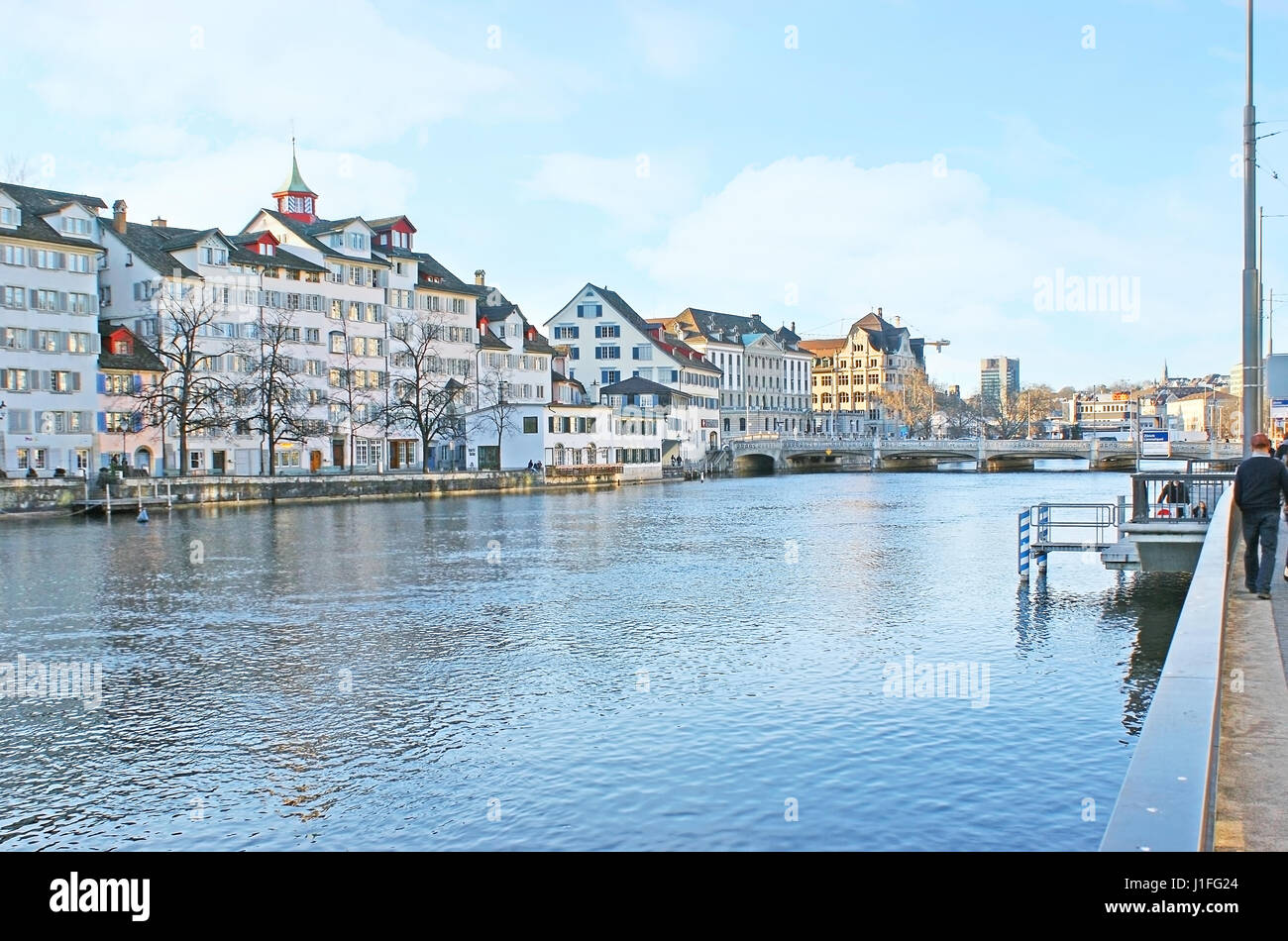 ZURICH, SWITZERLAND - MARCH 20, 2011: The walk on Limmat quay with a view on the houses and towers of Schipfe quarter, - Stock Image