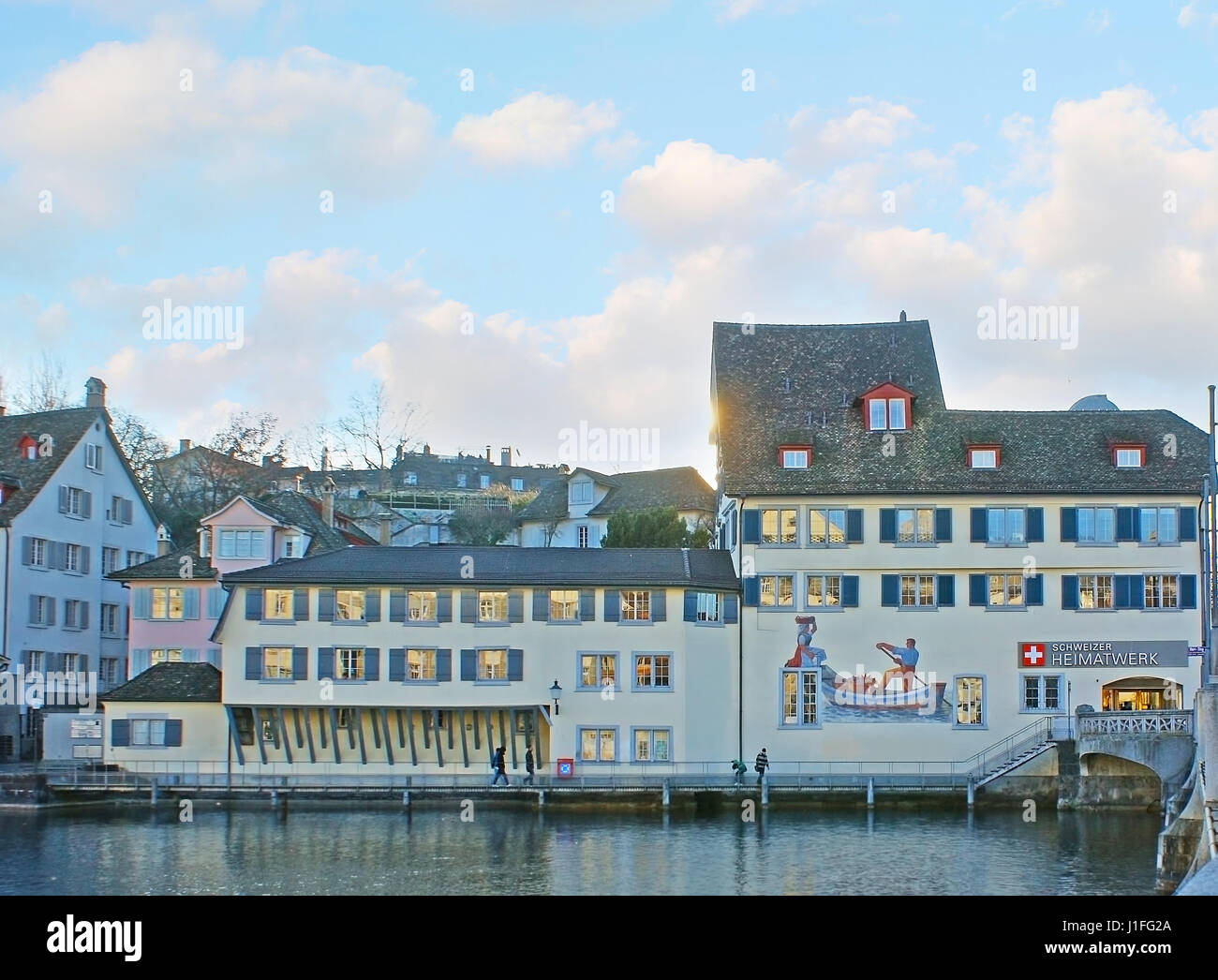 ZURICH, SWITZERLAND - MARCH 20, 2011: The old building on quay of Limmat River decorated with scenic mural, on March - Stock Image
