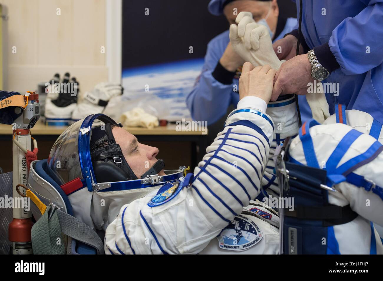 NASA International Space Station Expedition 51 prime crew member American astronaut Jack Fischer slips into his - Stock Image