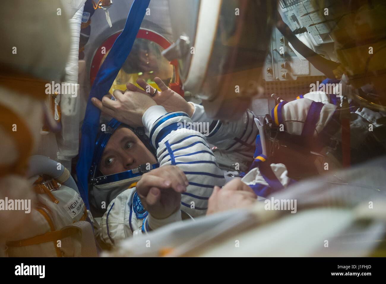 NASA International Space Station Expedition 51 prime crew member American astronaut Jack Fischer tests the Soyuz - Stock Image