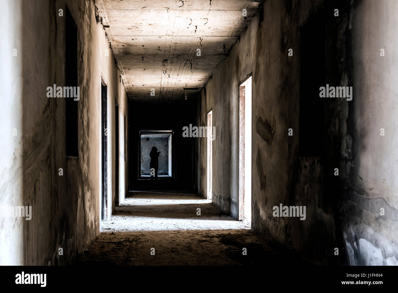 Abandoned building ghost living place with scary woman inside, darkness horror and halloween background concept - Stock Image