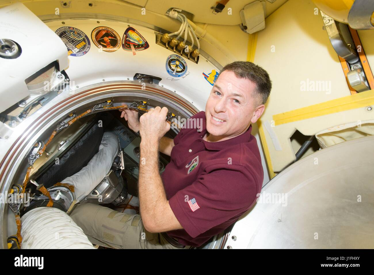NASA Expedition 50 prime crew member American astronaut Shane Kimbrough signs a bulkhead on the Russian segment - Stock Image