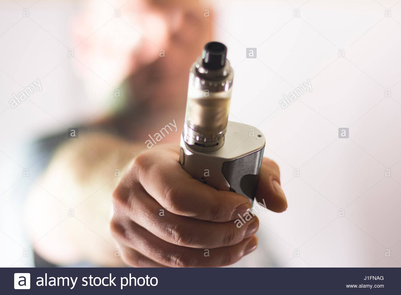 e cigarette on man hand  blurred background composition photograph - Stock Image