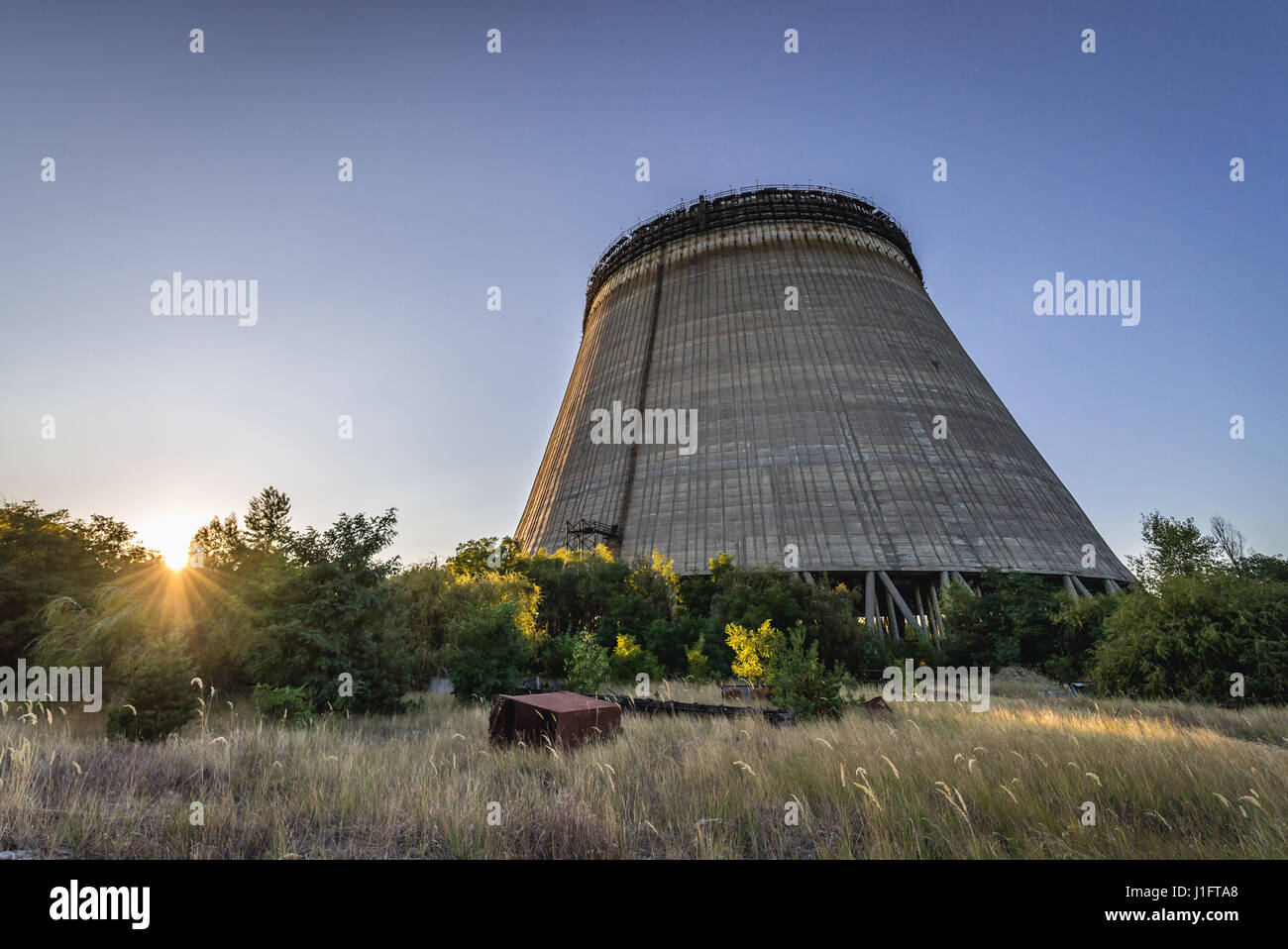 Cooling tower of Chernobyl Nuclear Power Plant in Zone of Alienation around the nuclear reactor disaster in Ukraine - Stock Image