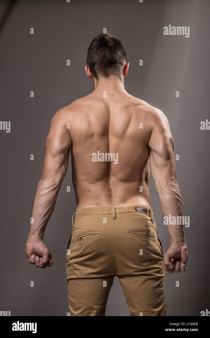young man bodybuilder back strong muscle rear view stock photo