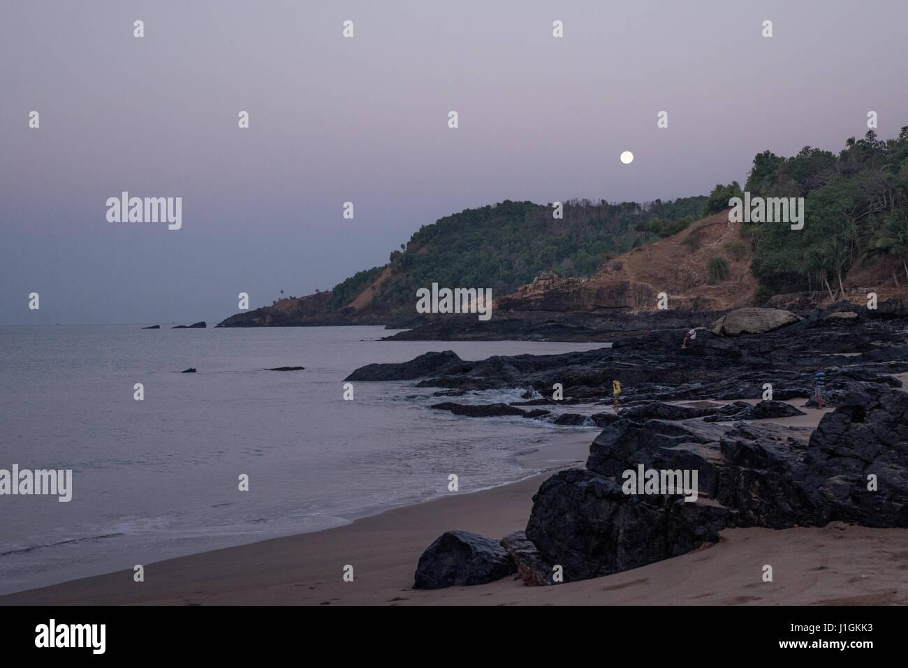 Moonset at paradise beach - Stock Image
