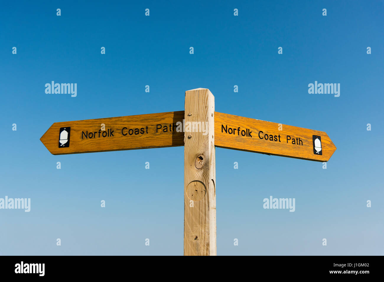 A signpost giving directions on the Norfolk Coast Path, a long distance footpath around the coast of Norfolk UK - Stock Image