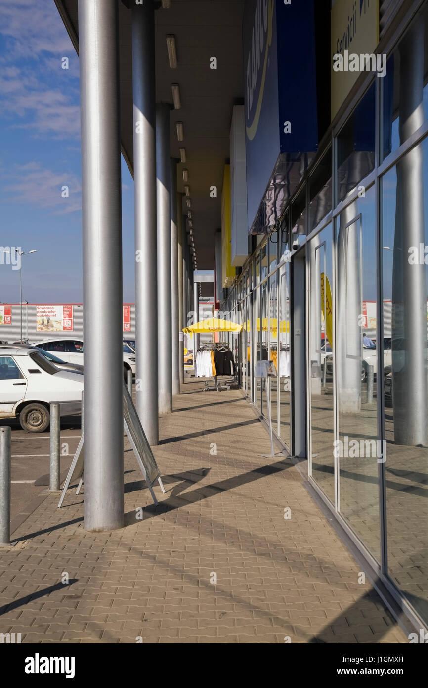 Strip shopping mall in the town of Giurgiu, Romania, Eastern Europe - Stock Image