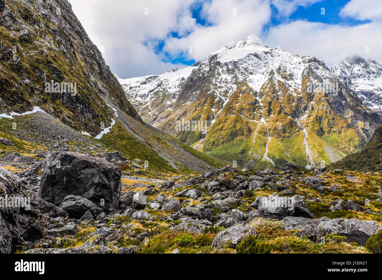 Snowy mountains in the Milford Road, one of the most beautiful scenic roads in New Zealand - Stock Image