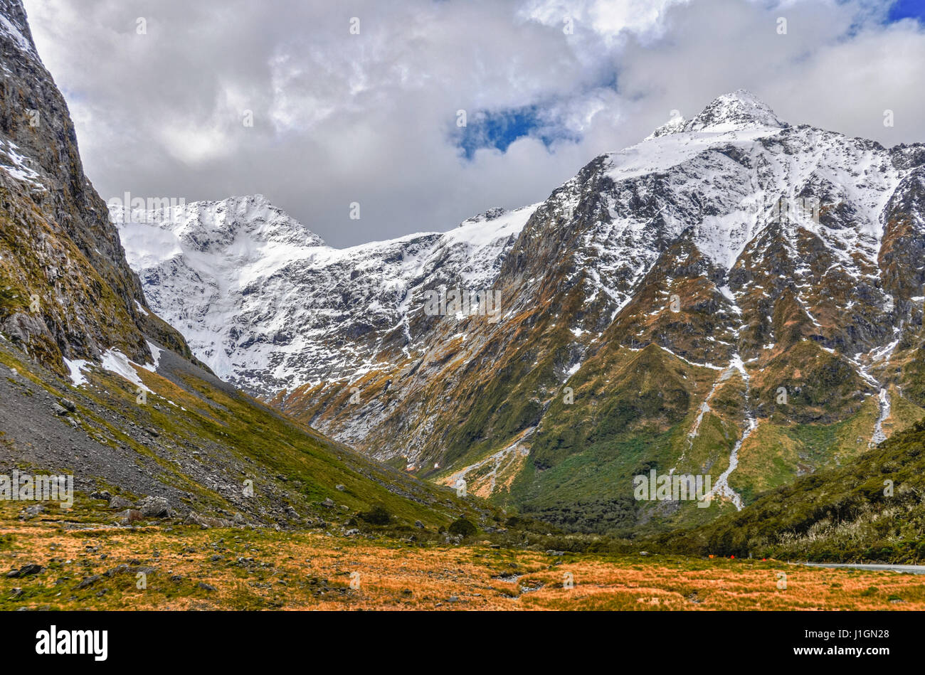 Snowy mountains in the Milford Road, one of the most beautiful scenic roads in New Zealand Stock Photo