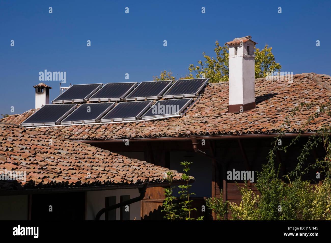 Solar panels on the roof of a residential home, Veliko Tarnovo village, Bulgaria, Eastern Europe - Stock Image