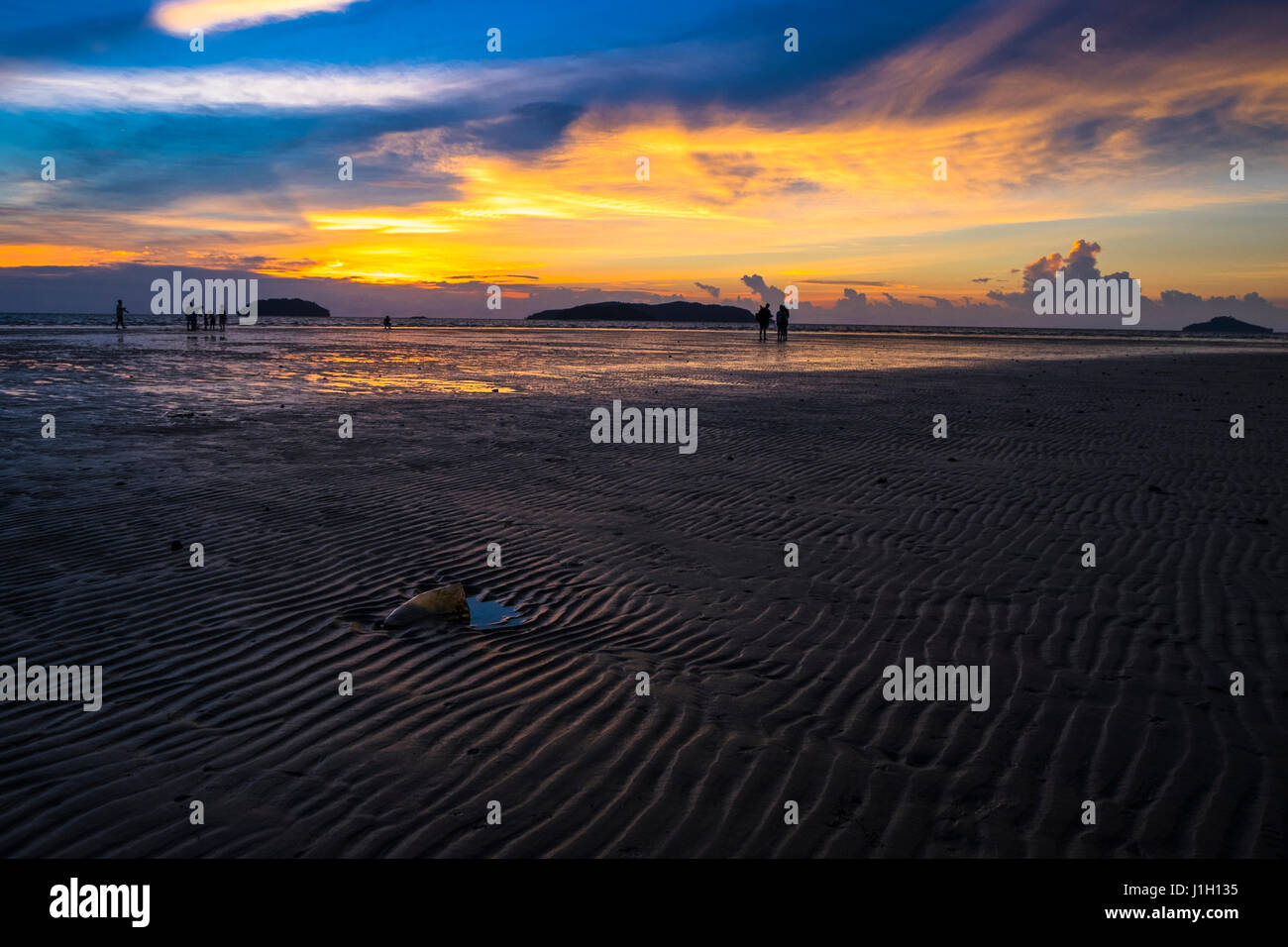 Twilight hour at Tanjung Aru beach in Sabah, Malaysian Borneo. Stock Photo