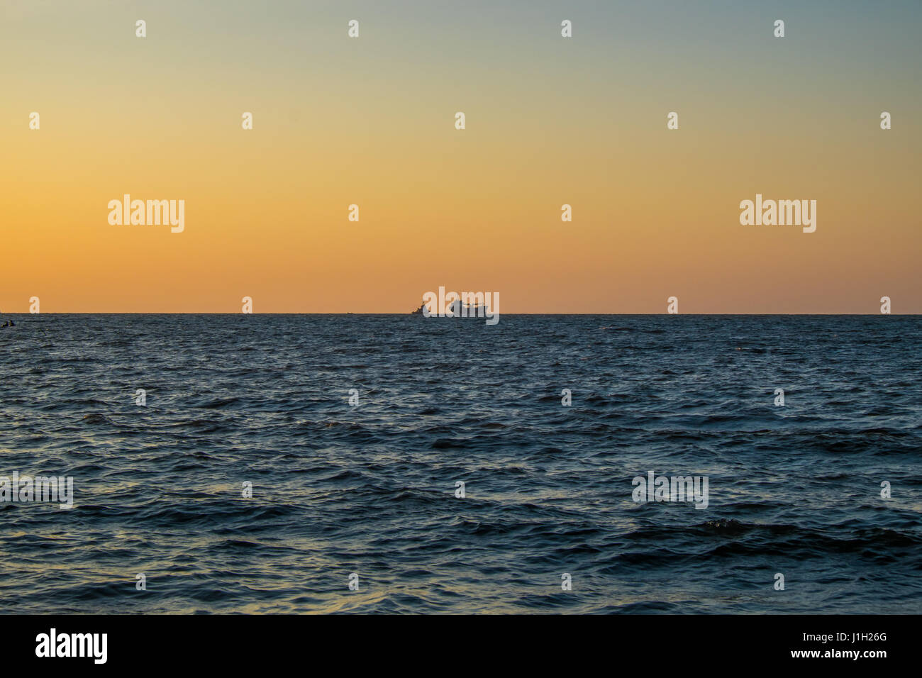 Ships berthed in the South China sea. - Stock Image