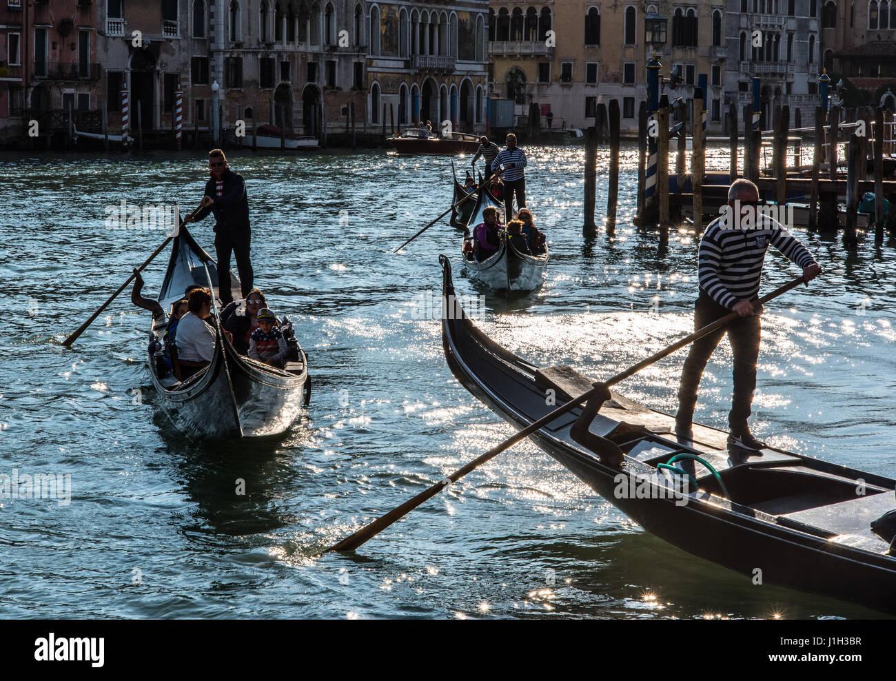Gondolas silhouetted against Grand Canal in evening near Ponte dell'Accademia bridge, Venice - Stock Image