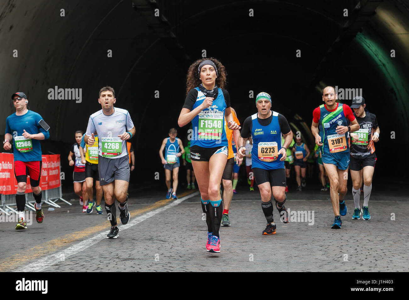 Rome, Italy - April 2nd, 2017: Athletes of the 23rd Rome Marathon to the passage of the tunnel Umberto I, a few - Stock Image