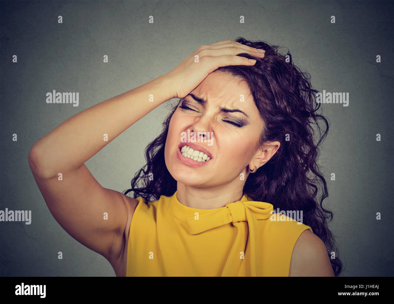 Regretful young woman made a mistake - Stock Image