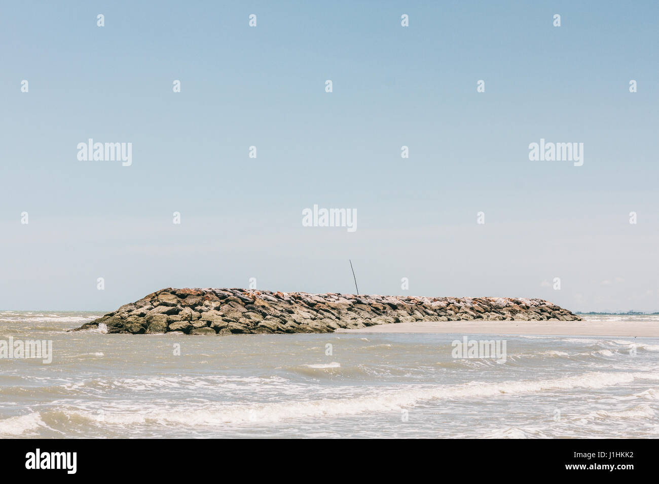A simple view of a coastline. - Stock Image