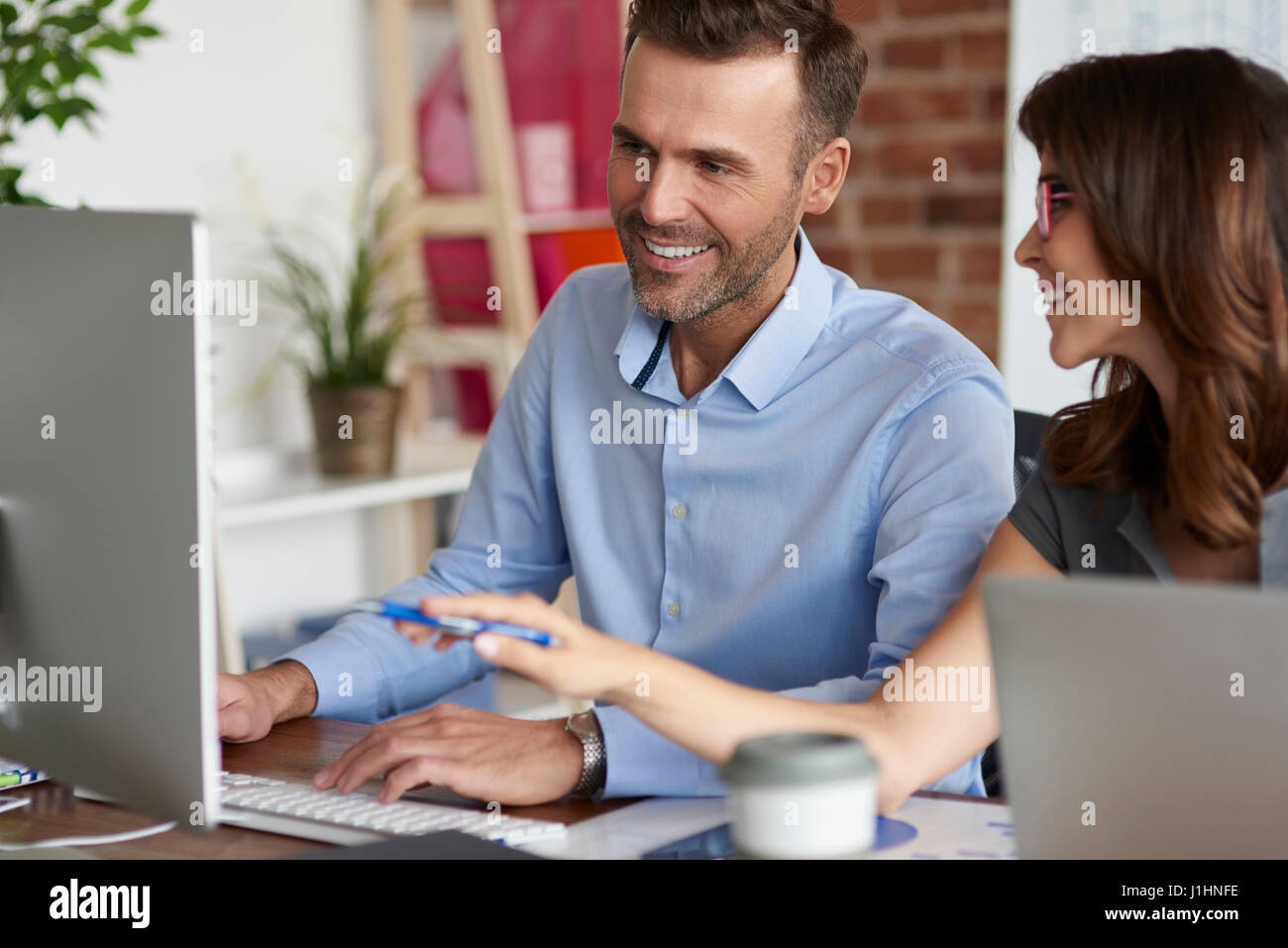 Colaboration of two young business people Stock Photo
