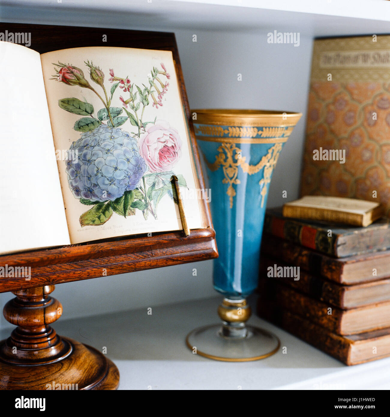 Book with flower illustration on stand. - Stock Image