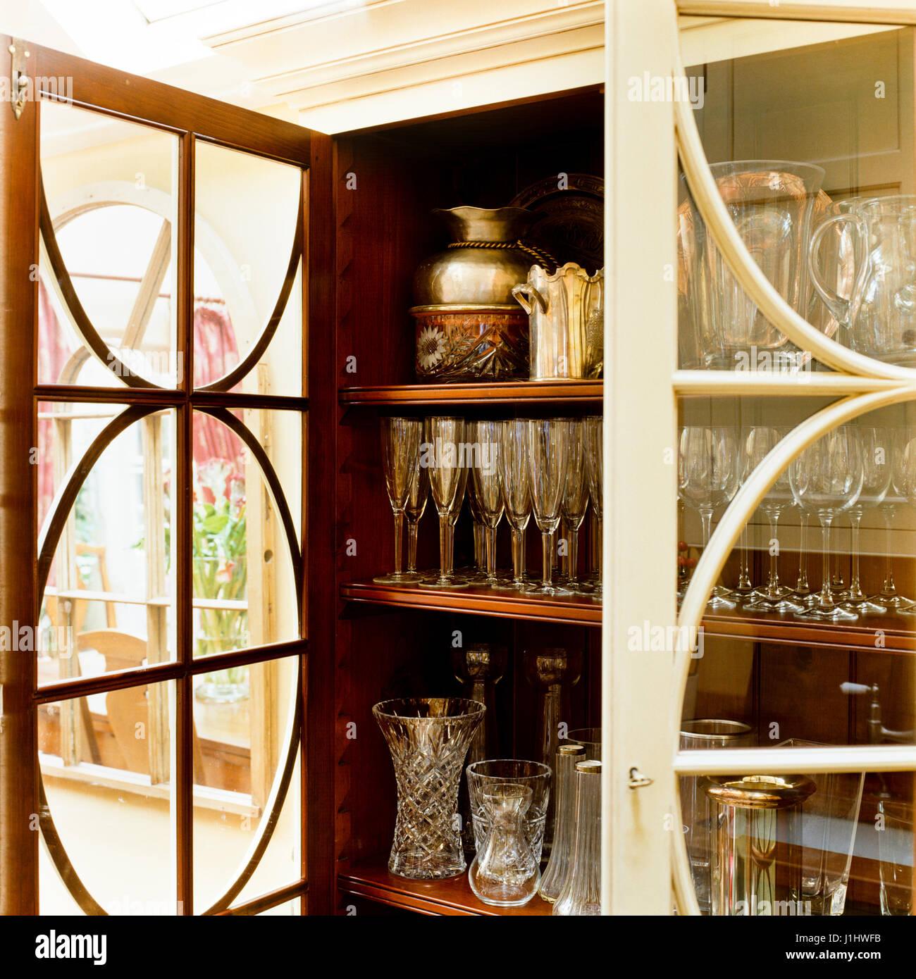Shelves of glassware. - Stock Image